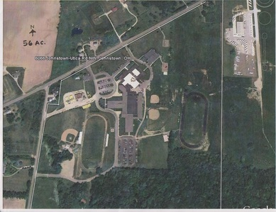 The bus garage will be in the south-east corner of the grounds, bordered in white. Photo from maps.google.com.